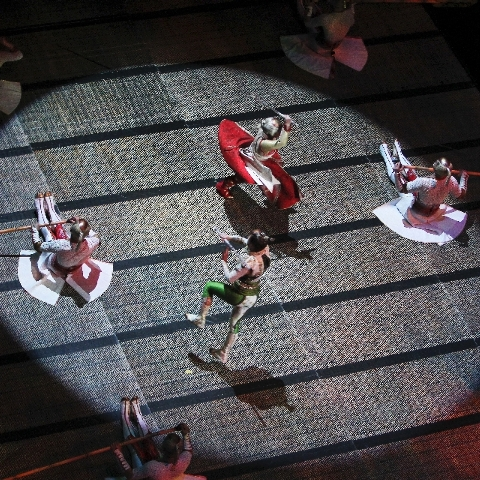 Performers in Cirque du Soleil's KA act out a battle scene at the MGM Grand in Las Vegas on Dec. 29, 2011.