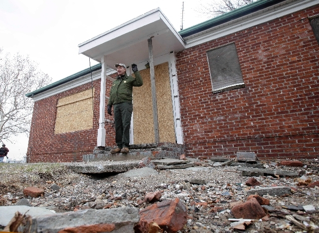David Luchsinger, superintendent of Statue of Liberty National Monument, and last resident of Liberty Island, poses for a photo at the back door of his Superstorm Sandy-damaged home, on Liberty Is ...