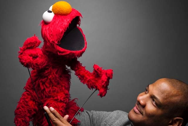 Elmo puppeteer Kevin Clash, shown in this 2011 publicity photo, will not face trial in three lawsuits that were thrown out of court in New York. A judge's decision published Monday said that the m ...