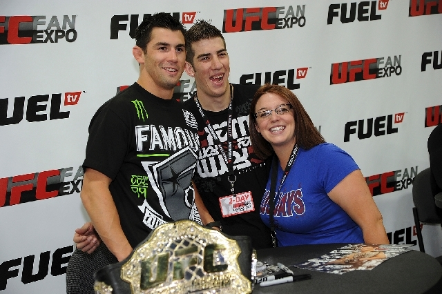 UFC bantamweight champion Dominick Cruz poses for a photo with fans in Las Vegas in 2012.