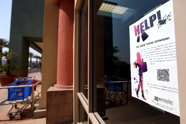 The commercial real estate firm NewMarket Advisors has placed fliers with QR codes on them in all the vacant windows of its shopping centers, as seen here Monday at a shopping center at the corner ...