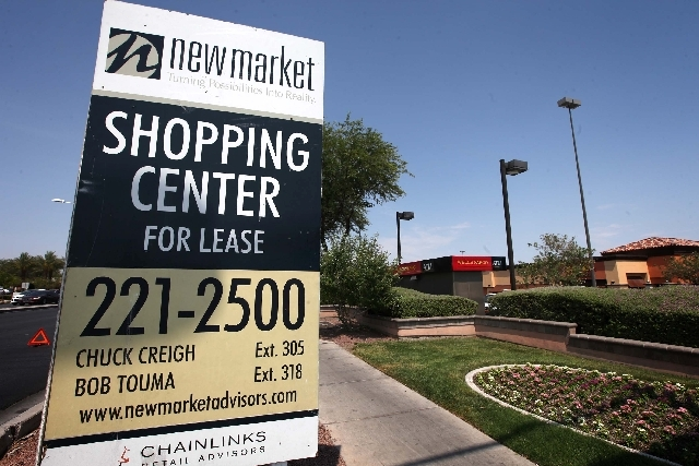 A sign advertises a shopping center with several vacant retail spaces Monday at Warm Springs Road and Stephanie Street in Henderson.