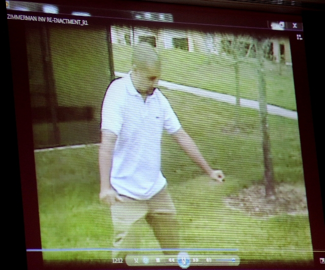 A reenactment video shows George Zimmerman with Sanford police investigators, taken the after the Trayvon Martin shooting, is projected for the jury during the 16th day of his trial in Seminole ci ...