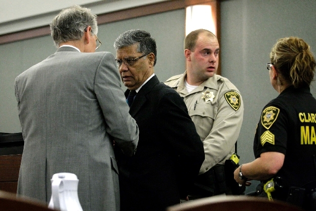 Dr. Dipak Desai, second from left, is remanded into custody by Clark County marshals at the Regional Justice Center in Las Vegas Monday after a jury found Desai and nurse anesthetist Ronald Lakema ...