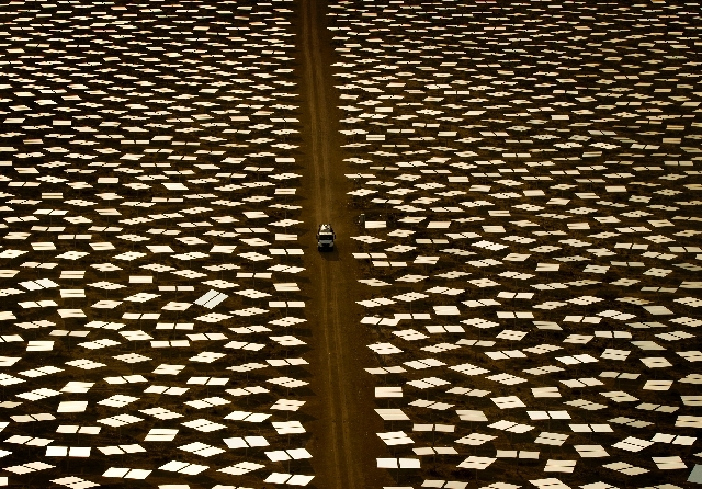 At California's Ivanpah Solar, near Primm, 3,500 acres of mirrors are used to focus sunlight onto three boiler towers to generate up to 377 megawatts of electricity, enough for more than 100,000 C ...
