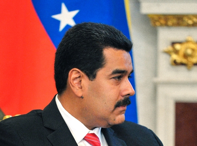 Venezuela's President Nicolas Maduro listens to Russian President Vladimir Putin, unseen, during their meeting Tuesday at the Kremlin in Moscow. Maduro told Russian reporters that his country has  ...