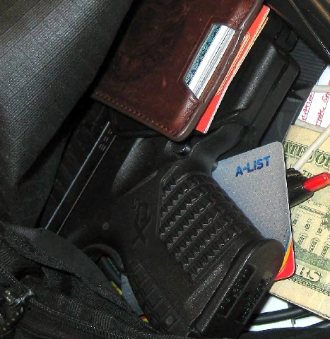This handout photo provided by the Transportation Security Administration (TSA), taken in April 2013 at Indianapolis International Airport, shows a gun among personal belongings that was confiscat ...