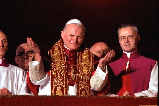 Pope John Paul II looks at a white dove released in honor of his repeated calls for peace by Roman youths in St. Peter's Square at the Vatican in 2003. A Vatican official says Pope John Paul II ha ...