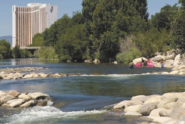 Reno police said two people died Monday after they were pulled from the Truckee River.