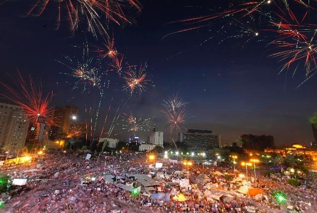 Fireworks burst over opponents of Egypt's Islamist President Mohammed Morsi in Tahrir Square in Cairo, Egypt, Tuesday.