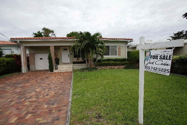 A single-family home is shown for sale in Surfside, Fla., in late May. U.S. home prices jumped 12.2 percent in May from a year ago, the most in seven years. The increase suggests the housing recov ...