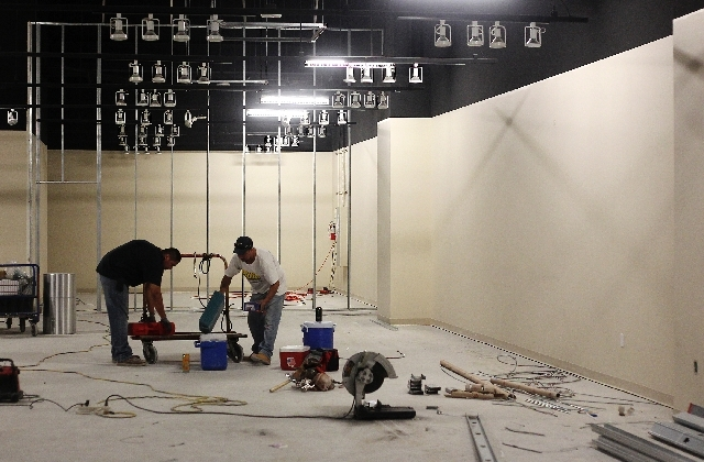 Ivan Aguilera, left and Luis Miramontes work to renovate a  showroom at the World Market Center in Las Vegas on July 2.