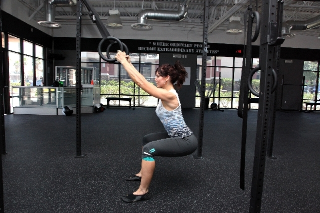 ASSISTED SQUATS ACTION: Hinging at the hip, and keeping the back straight, lower the hips to below the level of the knee. Contract the glutes and return to the starting position. Perform five to 1 ...