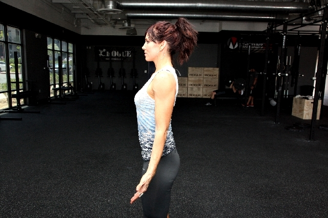 ACTION: Straighten the back. Without tilting the chin up, move the head back to its neutral position. If finding your initial alignment is difficult, then use a wall to help you get a sense of str ...