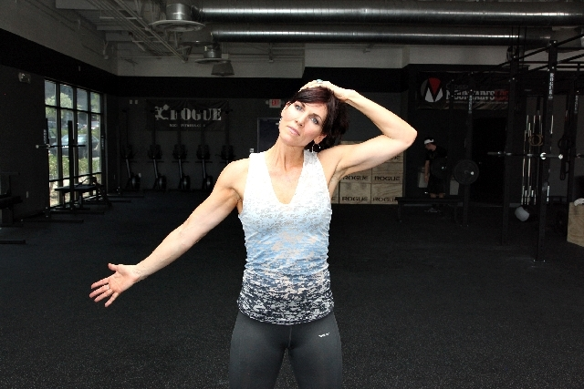 ACTION: With the other hand, gently pull the neck the opposite direction of the open hand. Hold the stretch for 20 seconds. Add to this stretch by gently pulling forward on the head. Perform the s ...