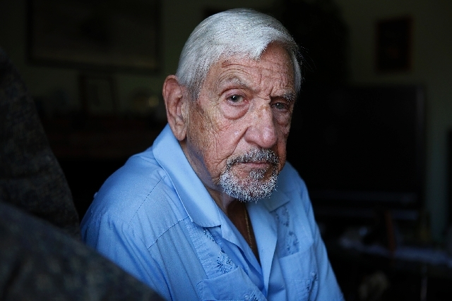 Alex Pomar poses for a portrait at his home in Las Vegas on Tuesday. Pomar was one of the people notified that he should tested for hepatitis C and HIV after visiting the office of Dr. Dipak Desai.