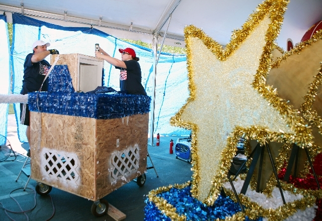 Tommy Porrello and Jennifer Wright work Tuesday on a float under a tent set up for parade decorations at Trails Park. The floats will be in the 19th annual Summerlin Council Patriotic Parade on Th ...