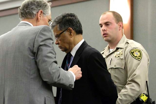 Dr. Dipak Desai, second from left, is taken into custody by Clark County marshals at the Regional Justice Center in Las Vegas on Monday after a jury found him guilty on criminal charges stemming f ...