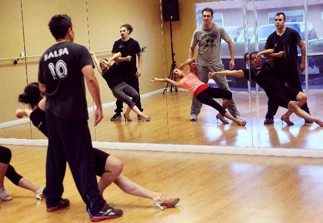 Nate Strager, middle in gray shirt, rehearses with the Sin City Salseros. The local dance group will participate in the Las Vegas Salsa Congress set for Thursday through Sunday, primarily at the T ...