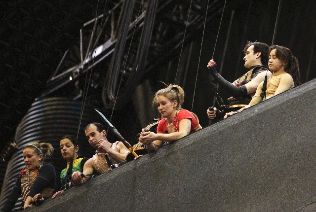 Sarah Guyard-Guillot, second from left, waits on top of the vertical wall with her fellow KA performers during rehearsal at the MGM Grand in Las Vegas on Dec. 29, 2011.