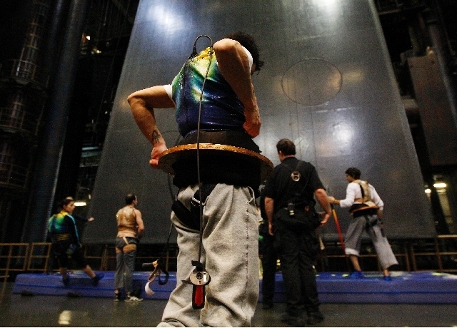 """Cirque du Soleil reopened """"Ka"""" Tuesday at the MGM Grand. This file photo shows Sarah Guyard-Guillot, far left, as she rehearses on a vertical wall with her fellow KA performers on Dec. 29, 2011. A ..."""