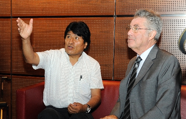 Bolivia's President Evo Morales, left, talks to Austrian President Heinz Fischer at Vienna's Schwechat airport, Wednesday. The plane of Morales was rerouted to Austria after various European count ...
