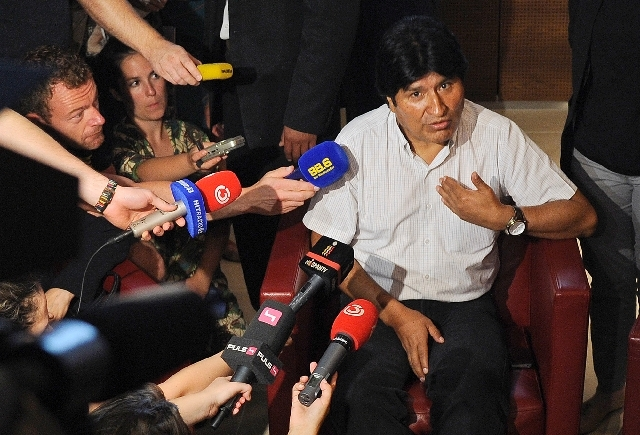 Bolivia's President Evo Morales talks to reporters at Vienna's Schwechat airport, Wednesday. The plane of Morales was rerouted to Austria after various European countries refused to let it cross t ...