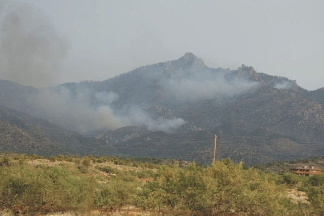 A wildfire burns Tuesday evening near Dean Peak in the Hualapai Mountains in northwest Arizona. The fire has grown to 3,200 acres since it started Saturday.