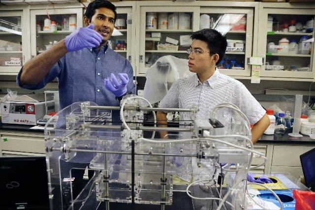 Princeton University graduate student Manu Mannoor, left, and Ziwen Jiang, a student from Peddie High School in Hightstown, N.J., prepare to use a 3-D printer, in Princeton, N.J. The scientists at ...