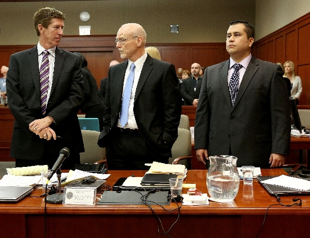 Defense attorneys Mark O'Mara, left, and Don West, center, stand with George Zimmerman during Zimmerman's trial in Seminole circuit court, in Sanford, Fla., Wednesday. Zimmerman is charged with se ...