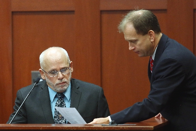 Jim Krzenski, of the Sanford Police Dept, left,  is shown a document by Assistant State Attorney Richard Mantei during the George Zimmerman trial in Seminole circuit court, in Sanford, Fla., Wedne ...