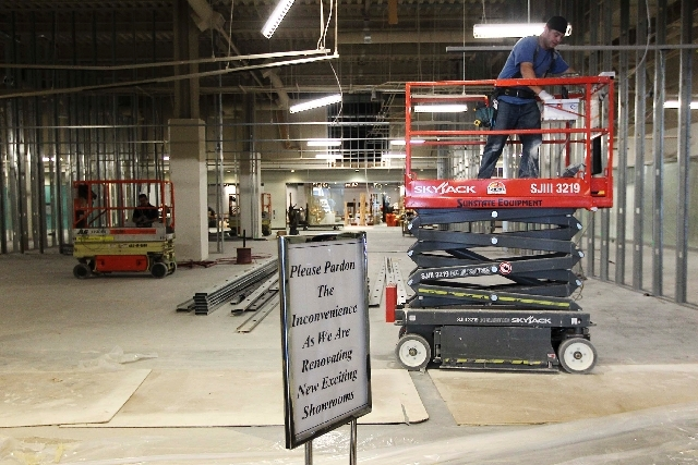 Construction worker Elvis Arostegui, right, runs electrical conduit Tuesday at a World Market Center showroom in Las Vegas. In the last 18 months, almost 600,000 square feet of new or expanded spa ...