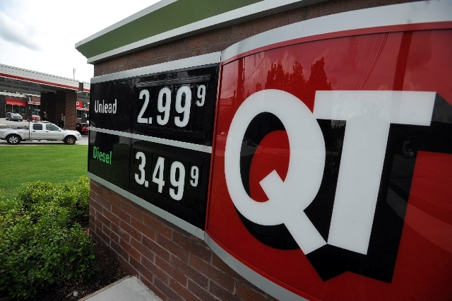 In this Monday, July 1 photo, a sign advertising unleaded gas for $2.99 is seen at a QuikTrip station in Greenville, S.C. Gasoline prices are on a summer slide, giving U.S. drivers a break as they ...