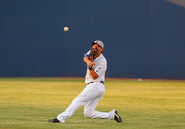 Las Vegas 51s infielder Wilmer Flores thorws the ball during the first inning as the team plays against the Fresno Grizzlies at Cashman Field on Tuesday.