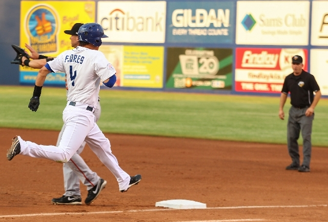 Las Vegas 51s infielder Wilmer Flores reaches first base during the first inning as the team plays against the Fresno Grizzlies at Cashman Field on Tuesday.