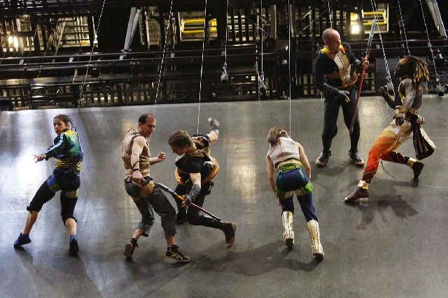 In this Dec. 29, 2011 file photo, Ka performers rehearse on a vertical wall at the MGM Grand in Las Vegas. The show reopened Tuesday night after the June 30 death of performer Sarah Guyard-Guillot ...