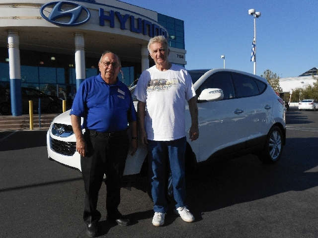 Planet Hyundai Sahara sales consultant Nick Asaro, left, has become the go-to person when Sam Bonica needs a new vehicle.