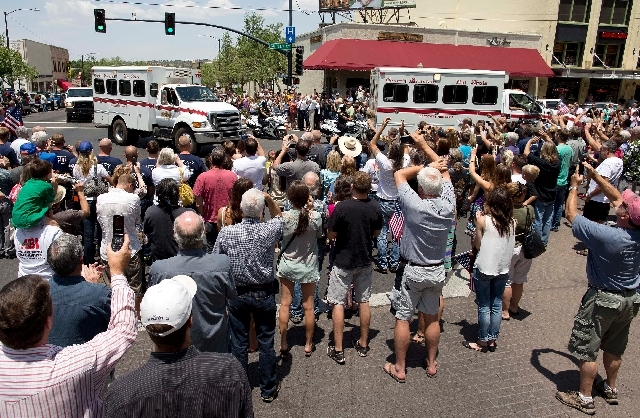 A crowd gathers to greet the Granite Mountain Hotshot crew trucks as they are driven through downtown Prescott Wednesday. Until Sunday, the quaint town was home to two of Arizona's 18 highly quali ...