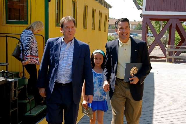 Lt. Gov. Brian Krolicki, from left, Marisa Sandoval and her father Gov. Brian Sandoval arrive by train at the Nevada State Railroad Museum in Carson City in this image provided by Nevada Magazine. ...