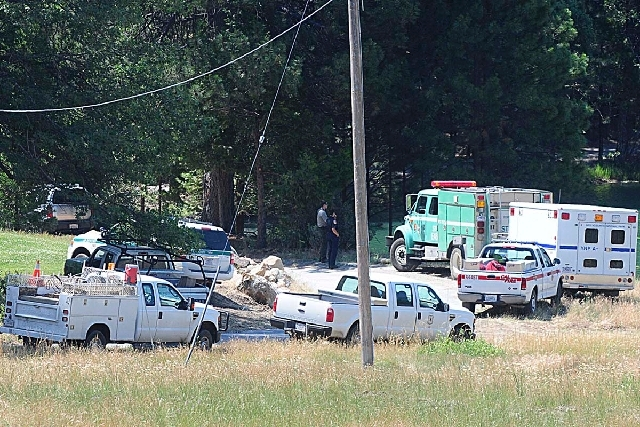 Emergency vehicles converge at Camp Tawonga in Groveland, Calif., on Wednesday. A 21-year-old summer camp worker was killed when a large oak tree fell at the site near Yosemite National Park.