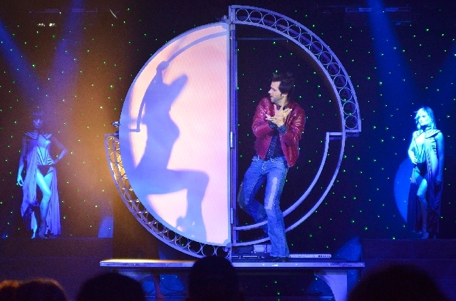 """Magician Jan Rouven performs during """"Illusions"""" at the Starlite Theater in the Riviera hotel-casino in Las Vegas in this Sept. 13, 2012, file photo. Rouven's show and the Riviera Comedy Club were  ..."""