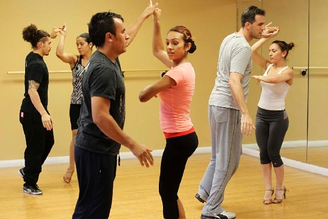 From left, Alexandro Delgado, Alejandra Magallon, Antonio Guevara, Azusena Saray, Nate Strager and Virginia Cano rehearse as the Sin City Salseros. The team, which has placed in world salsa champi ...