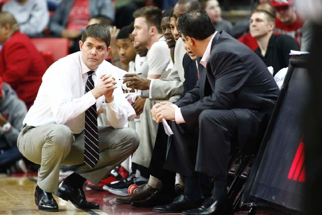 UNLV head coach Dave Rice talks with his coaching staff as the team plays Air Force at the Thomas & Mack Center in Las Vegas on January 12.