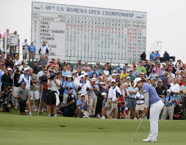 Inbee Park sinks her last putt Sunday at the U.S. Women's Open at Sebonack Golf Club in Southampton, N.Y. The Bishop Gorman grad has won the season's first three LPGA majors.