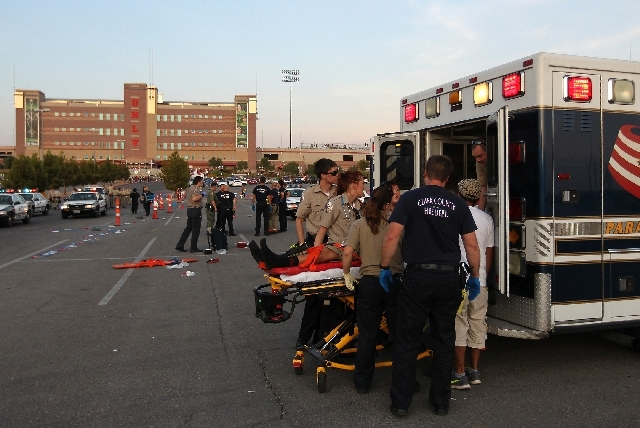 Emergency medical personnel load an injured soccer fan into an ambulance before the start of the game between Club America and Chivas at Sam Boyd Stadium in Las Vegas on Wednesday.