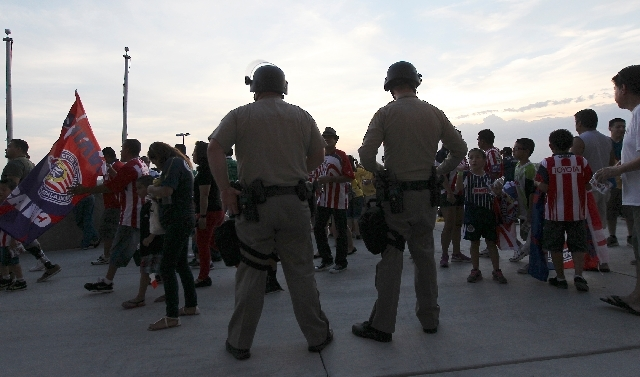 Police in riot gear stand at the ready before the start of the game between Club America and Chivas at Sam Boyd Stadium in Las Vegas on Wednesday.
