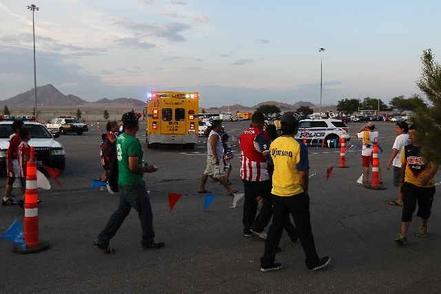 Fans walk past an ambulance after a fight broke out before the start of the game between Club America and Chivas at Sam Boyd Stadium in Las Vegas on Wednesday.