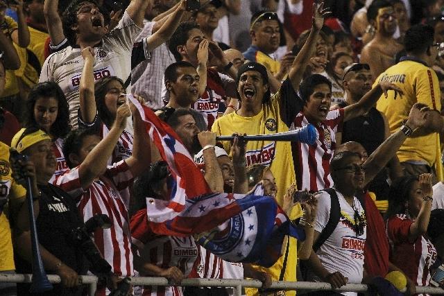 Fans of Chivas and Club America cheer at Sam Boyd Stadium in Las Vegas on Wednesday.