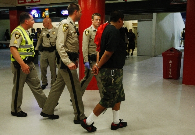 A fan gets arrested and escorted out of Sam Boyd Stadium during the Chivas vs. Club America game in Las Vegas on Wednesday.