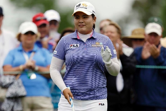 Bishop Gorman High School graduate Inbee Park waves to the crowd before teeing off in Sunday's final round of the U.S. Women's Open in Southampton, N.Y.